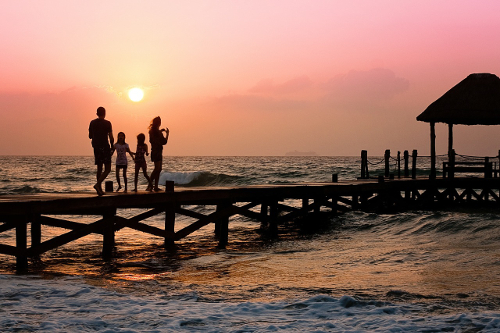 Family Walking on Pier